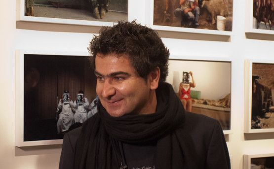 Jamal Penjweny and his work at the Pavilion of Iraq. Photo: Enrico Bottoni.